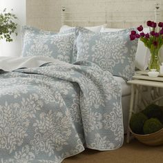 Reversible cotton quilt set with a floral motif.  Product:   Twin: Quilt and 1 standard sham     Full/Queen: Q...