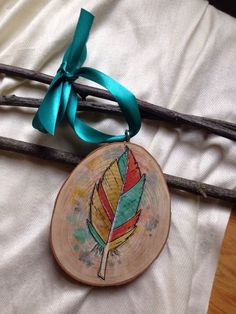 A personal favorite from my Etsy shop https://www.etsy.com/listing/167702322/large-boho-feather-christmas-ornament-4