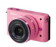 pink nikon J1 Omg I would love to have this. I seriously have always enjoyed taking pictures! I would love to have a great digital camera. Especially when the day comes that we have kiddos! I will document everything! Hehe! Wish list!!!!!