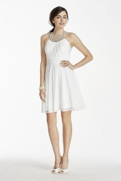 Go for a soft and fun look on your wedding day with this short chiffon dress!  Short chiffon dress with pearl and crystal beaded illusion neckline and exposed back.  Fully lined. Back zip. Imported. Dry clean only.