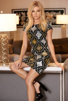 Stunning cap sleeve dress with patterned sequins that shimmer and shine.