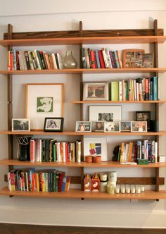 Bookshelf mixed with pictures, books, and other decor