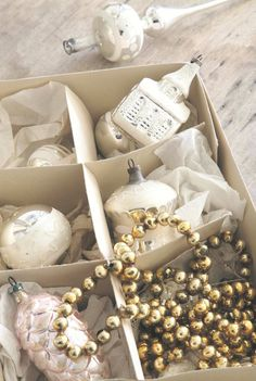 SEASONAL – CHRISTMAS – the first signs of christmas includes unpacking the first box of ornaments.