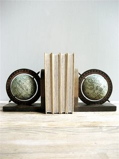 Great vintage collectible world Globe pair of wooden bookends in aqua tones. Great condition. Minimal wear    Each measures 5.75 wide x 6tall