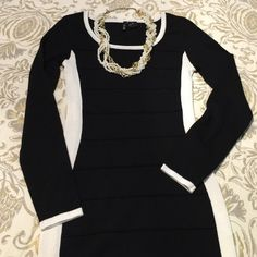 Black and white dress Black and white form fitting dress. Hangs right above your knees just depending on how tall you are. Ultra Flirt Dresses Midi