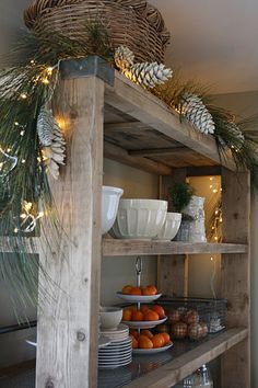 rustic shelves. I bet these would simple to make, probably could do it with pallets.