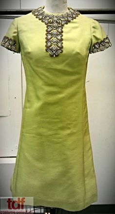 It seems there has been on a streak of 60s style outfits with beading embellishments! Here is a cute mod green dress with some beaded along the collar and sleeves. #TDFCC #KeepingUpWithTheCostumes #1960s
