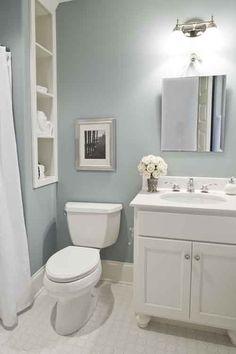 A simple, yet elegant main bath with linen shelves