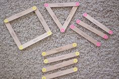 Geometric shapes with velcro popsicle sticks.