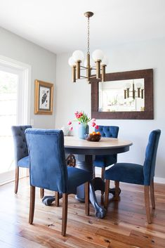 AfterThe blue chairs pop against the wood-grain floor.
