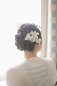 Beautiful bridal up-do with flower accessory. Photo by Nbarrett Photography. Flowers by Di Fiori. #wedding #hair #flowers