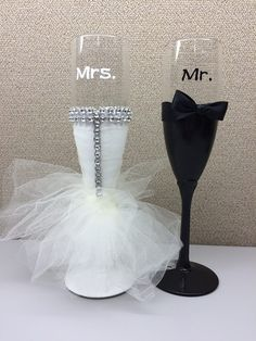 Mr. and Mrs. Champagne Flutes - the bride was hand painted then covered in a sparkly tulle dress with a touch of bling. The Groom was also hand painted and wrapped with a satin ribbon bow created by LessThanThree Designs.   www.facebook.com/lessthanthreedesigns