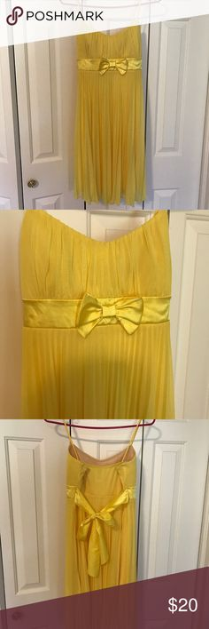 Spaghetti strap homecoming dress Above the knee, yellow, spaghetti strap homecoming dress. Worn once many years ago and I just want it out of my closet. MAKE AN OFFER. no trades. Dresses Prom