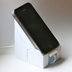 An handy stand/dock for iPhone from a simple A4 or Letter cardboard. Eco-iP4 is a lightweight and economic stand/dock which allows you to use your iPhone with a 45° inclination and a little space on your desk. You can use it with the USB cable attached and even with a cover on your device. Eco-iP4 allows you to use the rear camera and reduce motion blur, and, compared to other plastic docks, Eco-iP4 allows the use of the USB cable without stressing it. And it's completely ecological.