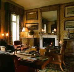 Gold wallpaper, towering walls, enormous mirror with fireplace below. No matchy furniture. .....   Eaton Square Dance: Designed by Christopher Hodsoll
