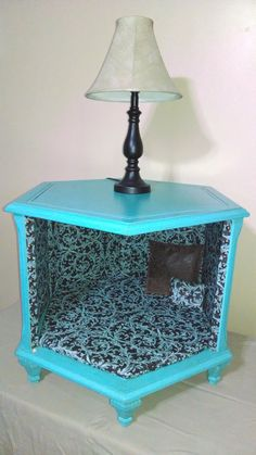 Re-purposed antique octagon end table turned into an adorable bed for your small to medium pet. Painted in a vibrant turquoise, distressed and sealed with an antique polyurethane finish. The interior is wrapped with a gorgeous brown and turquoise damask fabric, reinforced with rustic upholstery tacks, complete with custom hand-stitched bed and matching pillows.