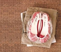 Wrapping your shoes in a shower cap is an awesome way to keep your other items clean.