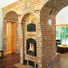 I'd like to see this with plaster Wood Stove Installation, Tyni House, Homestead House, Brick Masonry, Brick Architecture, Built In Ovens, Foyer Decorating, Dream House Exterior, Cabins And Cottages