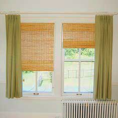 Woven shade with green curtain