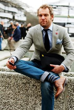 Detail in the socks... perfect. Grey blazer with rolled up jeans.