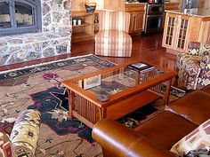 A Tufenkian Outlet traditional arts and crafts Tibetan rug featured in this cozy living room.