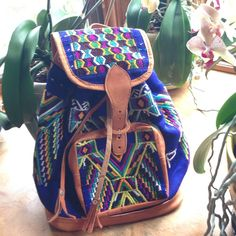 Boho backpack purse Handmade Guatemalan It's Free people style but not actually free people.  I went to Guatamala last year and had to have this awesome backpack purse but haven't used it so it's time to share with you! Is hand made from the artisans in Guatemala....if you look at Lauren Conrads the little market you will see some that she purchases from there! Lots of bright colors and details with tan leather Free People Bags Backpacks