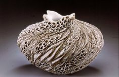 Anne Goldman's ceramics stop gallery clients in their tracks. Some are convinced that they are carved from coral outcroppings or canyon walls. (Lucky Street Gallery,540 Greene St, Key West)