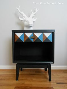 LOVE this idea of a) rehabbing a piece of furniture by painting a geometric design, and b) leaving a part of the natural wood serve as one of the design facets.