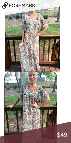 Stunning floral relaxed fully lined maxi dress! Beautiful colors in a floral pattern with v neck- rounded split hemline  Dresses Maxi