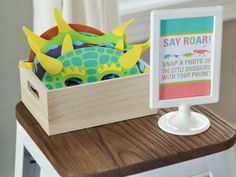Bodhi's dinosaur themed third birthday party with store-bought and budget-friendly decorations and food. Photo booth ideas.