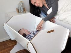 The Eco Cradle is made from cardboard, complies with European safety standards for cribs and cradles and it is cheap.