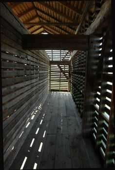From the inside looking out....long, wooden corn crib. This brings back a lot of memories of the farm!