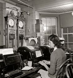 """Railroad Telegraphy March 1943. """"Seligman, Arizona. Teletype operator in the telegraph office of the Atchison, Topeka, and Santa Fe Railroad."""""""