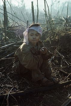 12/8/1967- Bu Dop, South Vietnam - A 15-year-old Viet Cong prisoner smokes a cigarette given him by his 1st Infantry Division captors. Image by © Bettmann/CORBIS ~ Vietnam War