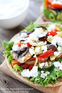 Roasted Vegetable Pita Sandwich Recipe on http://twopeasandtheirpod.com This easy and healthy sandwich is full of flavor.