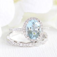 La More Design's Oval Aquamarine Halo Diamond Engagement Ring with Scalloped Diamond Wedding Ring makes for a gorgeous and elegant bridal set ~