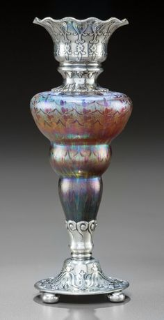 Rare Tiffany Studios Favrile Glass and Silver-Mounted Bud Vase Circa 1910. Stamped TIFFANY & CO, MAKERS, STERLING Ht. 5-3/4 in.