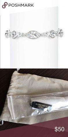 Givenchy Swarovski Crystal Bracelet Givenchy Crystal Bracelet. New with tags and bag. One size, rhodium. Fold over closure. Real Swarovski Crystals Givenchy Jewelry Bracelets