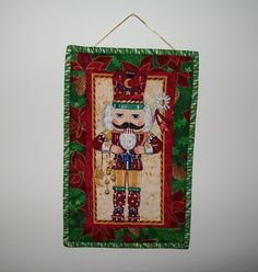 Nutcracker door hanging - red green gold quilted wall hanging - small Christmas hanger - poinsettia border - coworker hostess gift by ExpressionQuilts on Etsy
