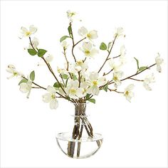 "Simple and romantic, our faux dogwood blossoms look freshly gathered from the garden. Brighten up your desk at work or place in bathroom to liven up the wallpaper.  The glass decanter vase gives the illusion of water.  17""W, 12""D, 15""T."
