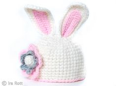 This handmade crocheted easter bunny rabbit hat for all ages and is made out of soft gray wool yarn with pink insets in the ears.