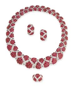 DAVID MORRIS The necklace designed as two graduated rows of ruby clusters to the brilliant-cut diamond ribbon, earclips and ring en suite