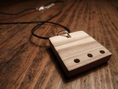 Necklace with wooden pendant. Olive wood pendant. Wooden modern jewel.