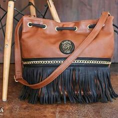 Brown bucket handbag with black fringe and chain detail. H113-00 @ R595 ronel.cazabella@yahoo.com Bucket Handbags, Chain, Detail, Brown, Black, Fashion, Moda, Black People, Fashion Styles