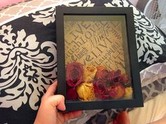Really awesome way to keep flowers :) Shadow box+ dried roses+ scrapbook paper= super cute and easy!