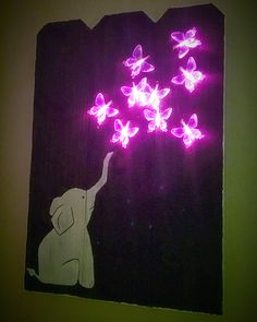 Glowing LED art on fence post. Nursery decor. Rustic. Elephant and butterflies. www.facebook.com/laurensmithLED