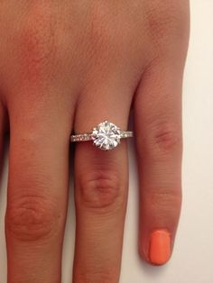 Classic 6 prong setting with pave band... stunning engagement ring!