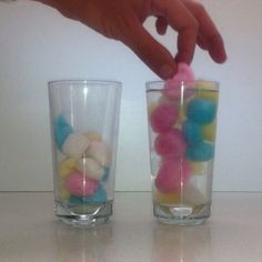 Cotton ball science. 1 cold water glass, 1 hot water glass, see how fast cotton balls drop in hot vs cold water