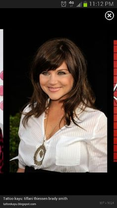 Tiffany Amber Thiessen hair style