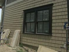 Image result for DARK SIDING WITH DARK WINDOW FRAME